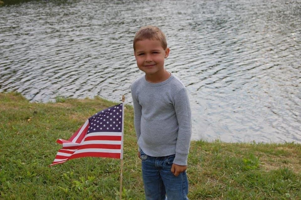 young boy with flag