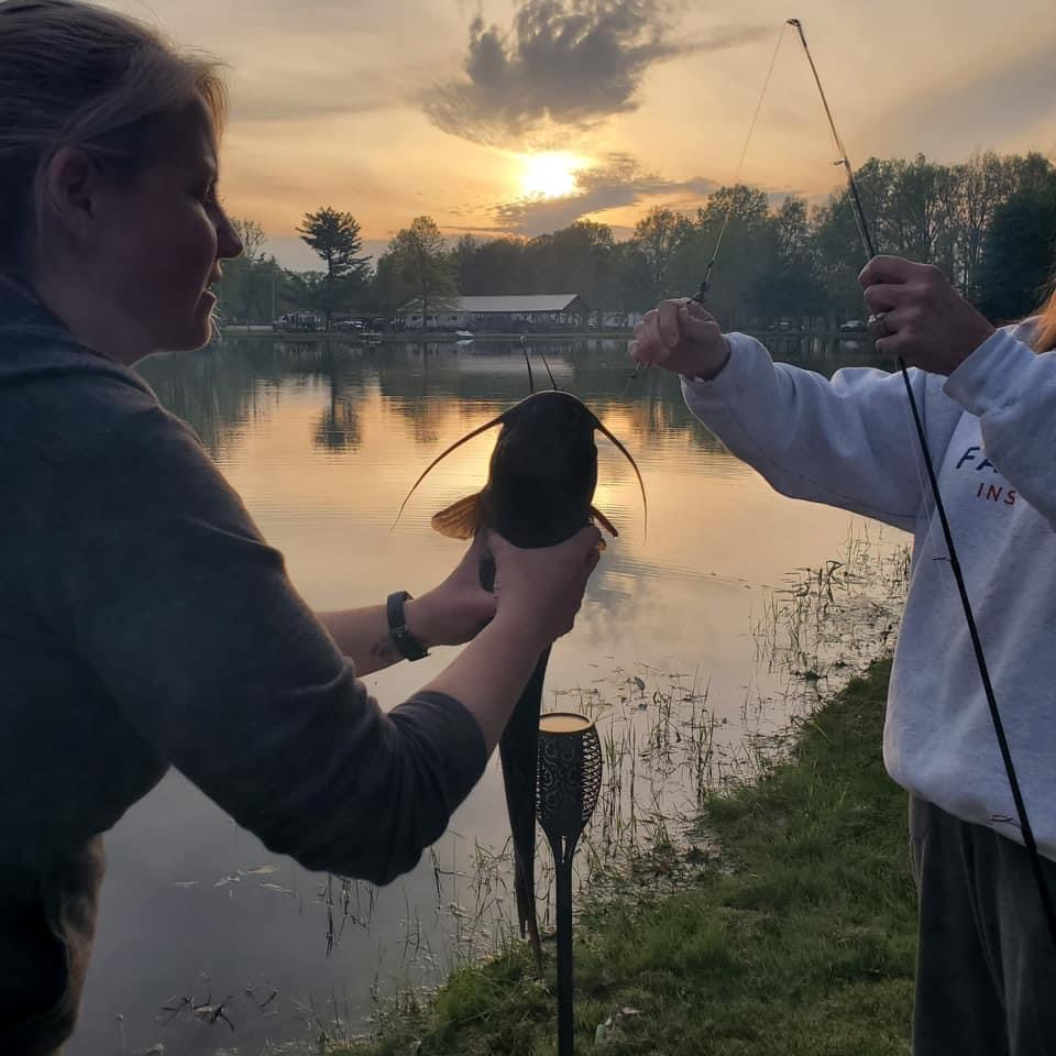 people fishing with catfish