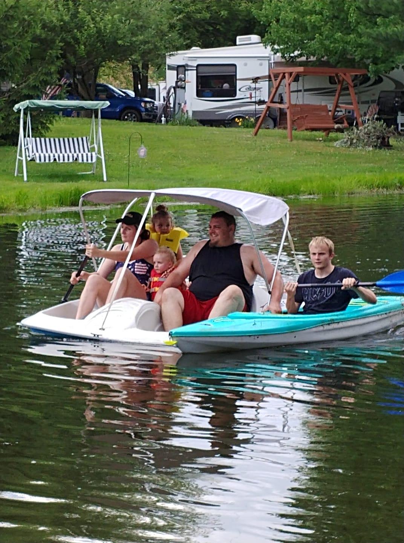 photo of family paddle boating